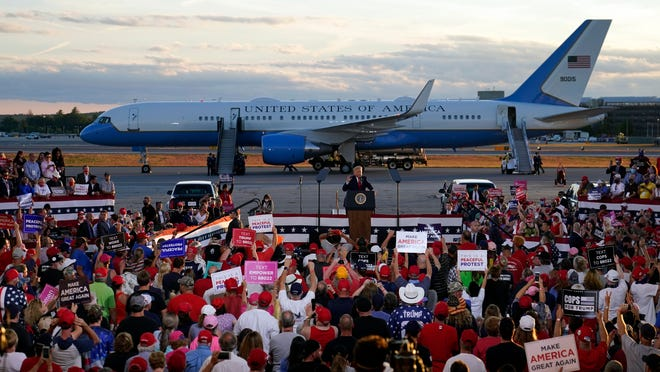 President Donald Trump speaks during a campaign rally at Manchester-Boston Regional Airport on Friday in Londonderry, N.H.