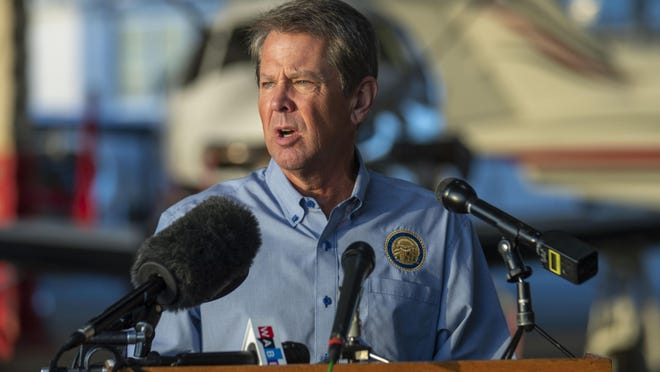Gov. Brian Kemp speaks during a news conference at DeKalb-Peachtree Airport in Atlanta on Sept. 4. Kemp signed an executive order Tuesday that lifts a ban on nursing home visitors implemented on April 8, but not for all long-term care facilities.