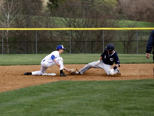 Waynesboro's Elliot Swink tags out a Cedar Cliff runner at second base. The Indians suffered their first loss of the season, a 9-7 defeat by the Colts.