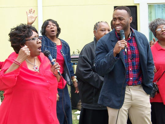 Marie Hammond and Kirk House sing while leading the New Light Baptist Church choir during the Gospel Brunch that concluded the 2016 Key City Rhythm & Blues Festival, a benefit event for United Way of Abilene.