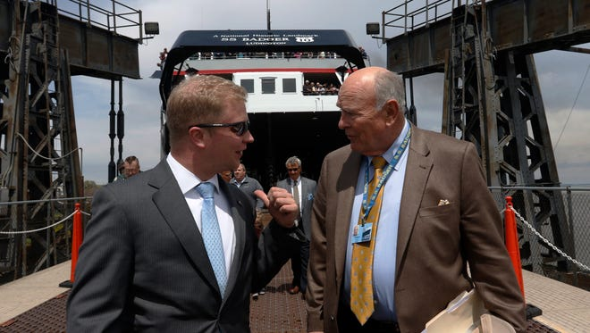 Mayor Justin Nickels, left, welcomes Bob Manglitz, President and CEO of Lake Michigan Carferry, Thursday as the S.S. Badger arrives in Manitowoc on its maiden voyage of the 2016 season. The Badger was designated a National Historical Landmark in February.
