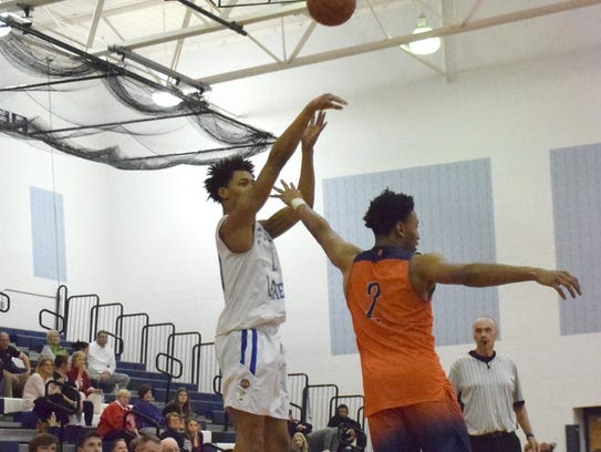Robert E. Lee's Jarvis Vaughan fires up a 3-point attempt