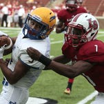 Jalen Walker of Carmel makes a catch just in bounds in front of Tyler Richardson of La Salle.