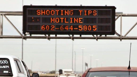 Freeway Shooting Info Hotline information on transit signage in Phoenix.