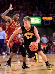 Iowa's Brady Ellingson drives against Iowa State's