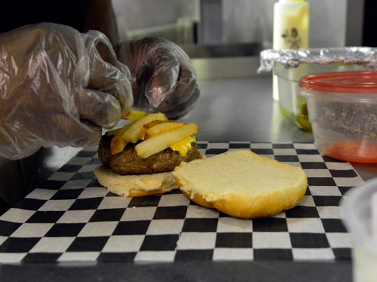 Head burgermaster Marvin Johnson puts together a Roth-lis-burger