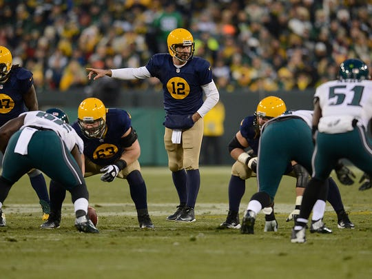 Green Bay Packers quarterback Aaron Rodgers (12) gives instructions to his teammates against the Philadelphia Eagles at Lambeau Field.
