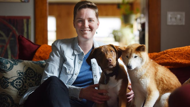 Calli Johnson with her dogs, Otto and Kaida, at her home that she rents in downtown Sioux Falls on Friday morning.