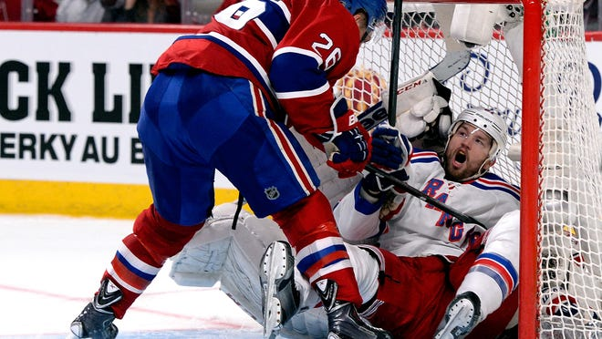 The Rangers' Rick Nash crashes into Canadiens goaltender Dustin Tokarski during Game 5 of the Eastern Conference final on Tuesday night.