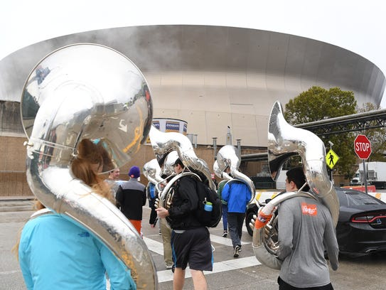Tiger Band members walk to practice in the Superdome
