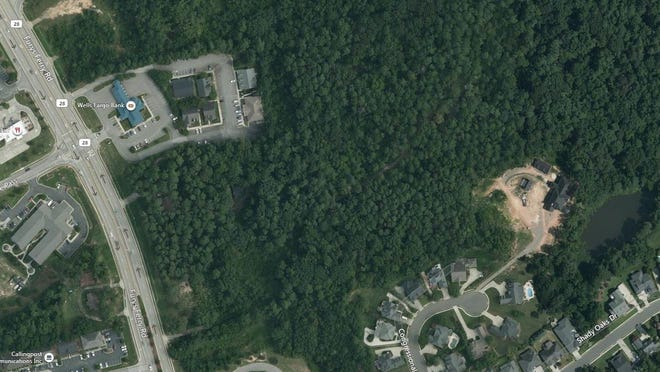 A satellite aerial shows the area between the Wells Fargo bank branch on Furys Ferry Road and the edge of the West Lake neighborhood where an affordable housing developer seeks to build 38 rent-subsidized units.