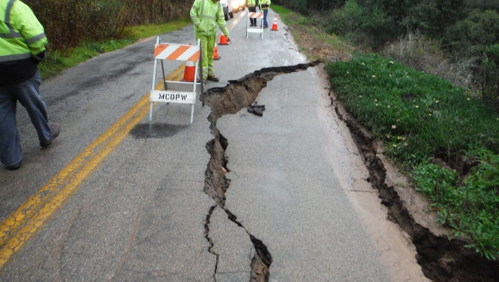 Monterey County estimates damages at $53.5 million from the recent winter storms. Workers review damage to Elkhorn Road.