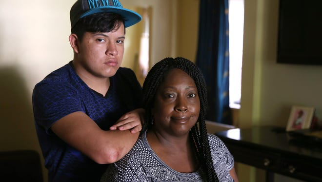 Giezi Gonzalez,19, with his foster mom, Barbara Hines Bell,   left his family in Honduras at 13 and came across the border from Mexico in Texas.  He lives with his foster mother in Rochester.