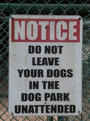 Warning signs and park rules are posted outside of most area dog parks.