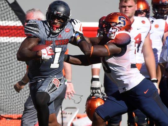 North Carolina State back Jaylen Samuels (1) runs the