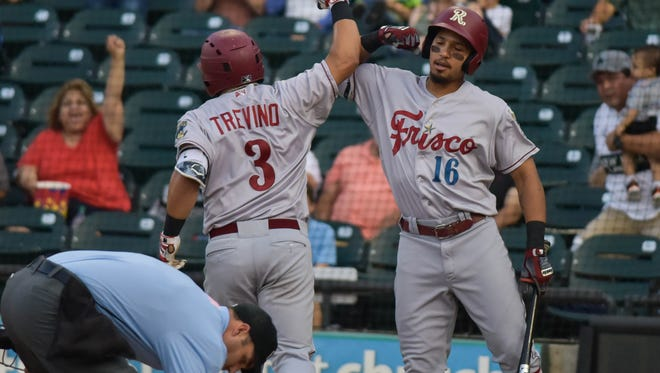 Frisco catcher and Corpus Christi native Jose Trevino is congratulated by teammate Luke Tendler during Friday's game at Whataburger Field.