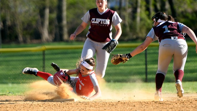 Fair Lawn's Amanda Kopf, left, has her helmet knocked off after being tagged by Clifton's Gianna Casillas, right. Fair Lawn girls softball defeated Clifton 12-3 in Clifton, NJ on Monday, April 17, 2017.
