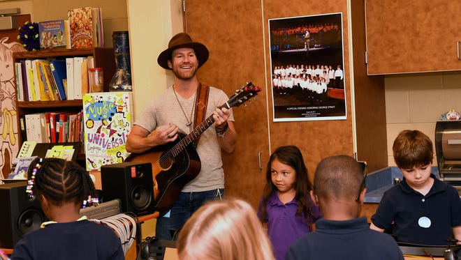 Singer-songwriter Drake White sings along with Eakin Elementary students in a VH1 Save the Music Foundation visit.