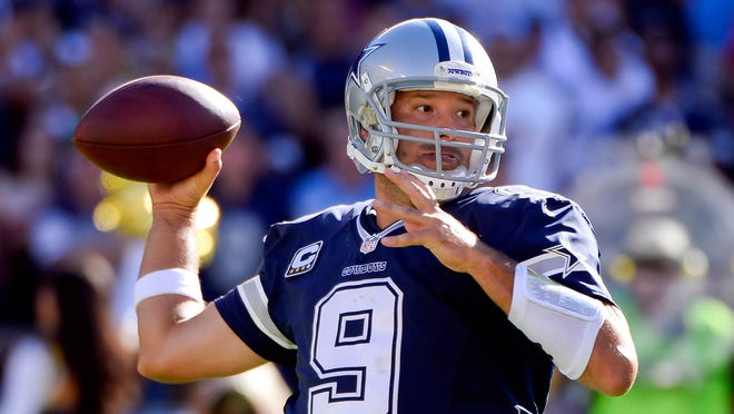 Dallas Cowboys quarterback Tony Romo (9) throws a pass in the fourth quarter against the San Diego Chargers at Qualcomm Stadium. Romo was 27 of 37 passing for 244 yards and two touchdowns.