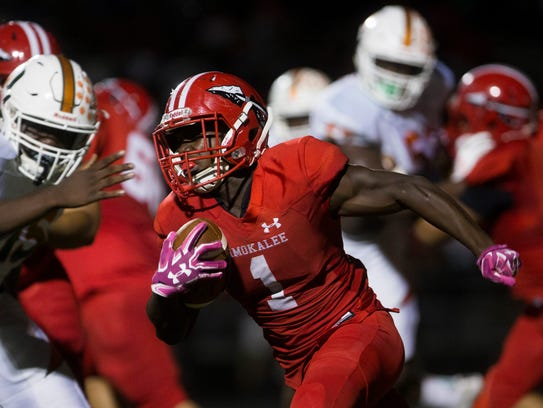 Immokalee's Fred Green (1) carries the ball against Dunbar in the first half of a District 12 varsity football matchup earlier this season. Green has topped 1,000 yards for the second straight season.