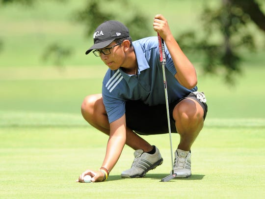 Rising Wylie senior Phillip Hurtado lines up a putt
