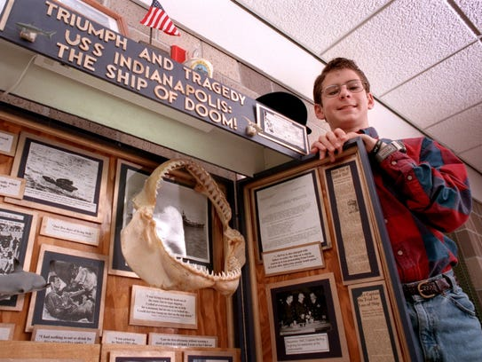 Hunter Scott poses in 1998 with his project that helped