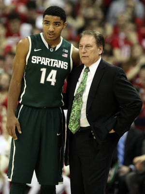 Michigan State Spartans guard Gary Harris (14) talks with head coach Tom Izzo with the Wisconsin Badgers at the Kohl Center. The Badgers won 60-58.