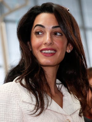 Amal Alamuddin Clooney during a visit at the Parthenon hall inside the museum in Athens on October 15 in Athens, Greece.