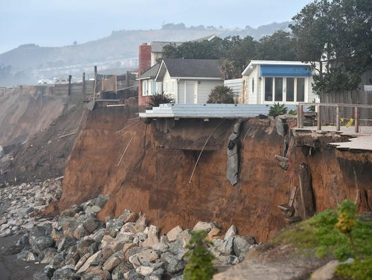 Sections of land are missing from coastal properties in Pacifica, Calif., on Jan. 26, 2016. Storms and powerful waves caused by El Nino have intensified erosion.