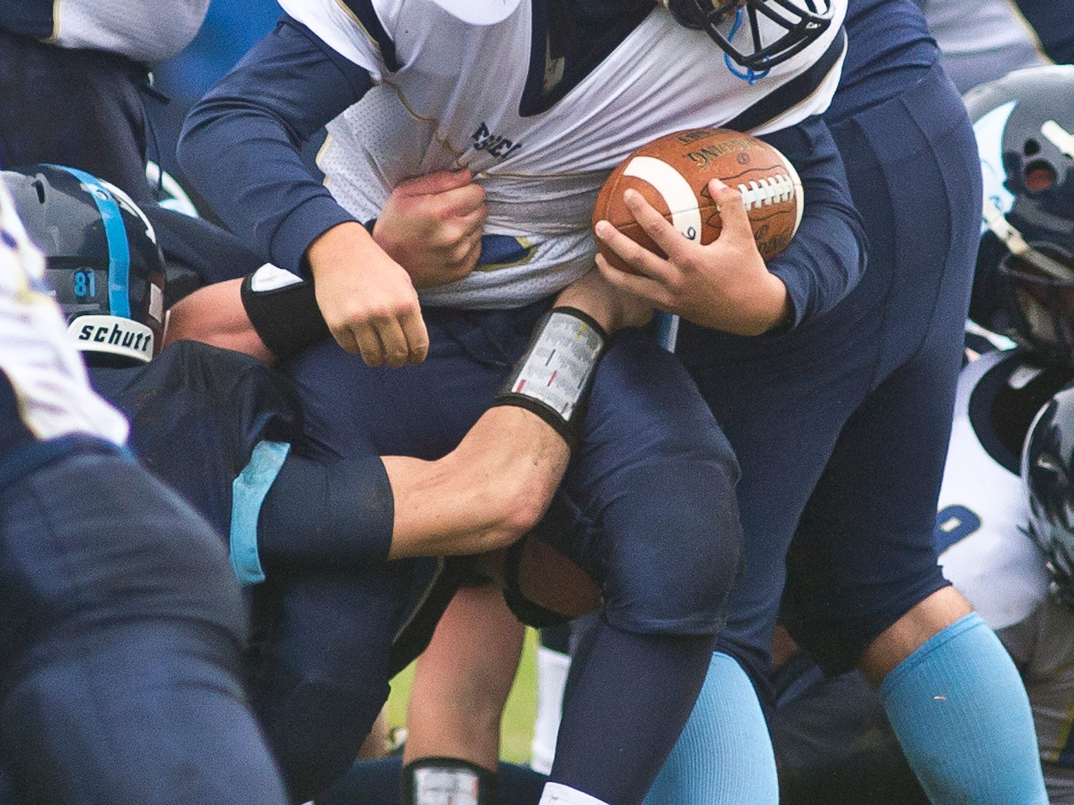 Essex High School's #6 Joey Robertson gets caught in a log jam of linemen, including MMU's #81Justin Fischer during Saturday's game in Jericho.