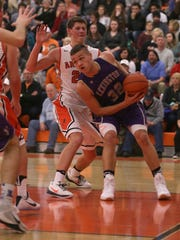 Cade Stover drives through the Arrows' defense during Lexington's road game against Ashland on Friday night.