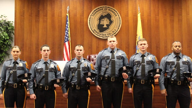 Taylor Deickman, Matthew Mangarella, Douglas Perrone, Sean Meagher, Patrick McCann and Marc Tyson were sworn in as Monroe's newest police officers during Monday's Township Council meeting.
