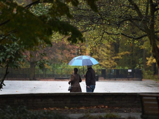A couple braved the rain at Van Saun Park in River