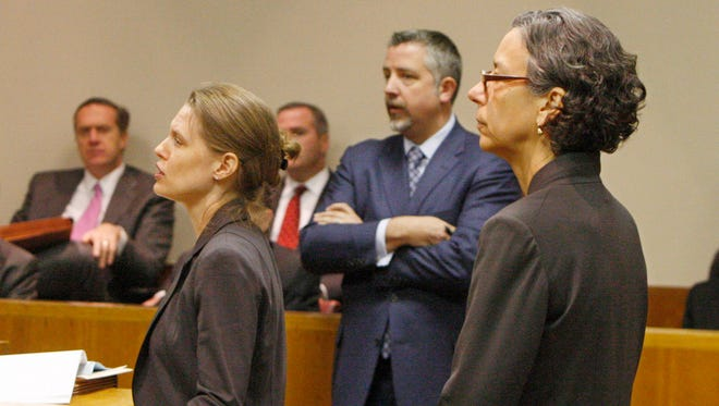 Ann Marie Preissler, an attorney with the AG's office, argues against dropping the charges against Robert Wiesner, as his lawyer, James Nobles, center, looks on during a hearing into the LDC corruption case in December.