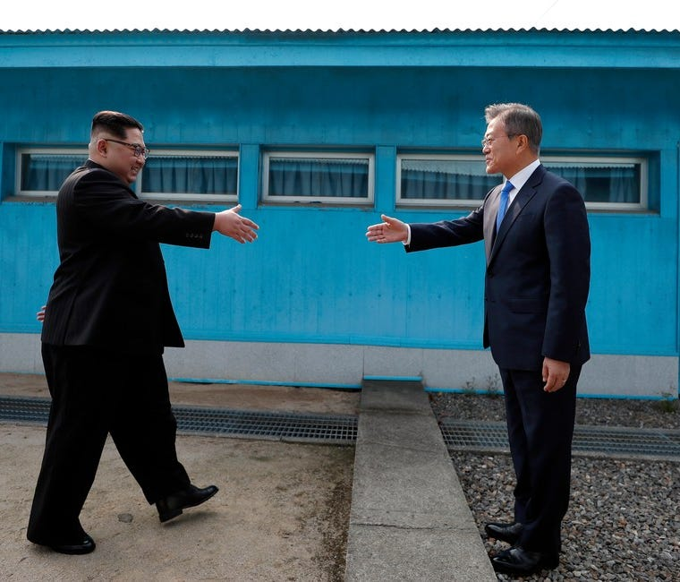 North Korean leader Kim Jong Un, left, shakes hands with South Korean President Moon Jae-in, in  the village of Panmunjom in Paju, South Korea, on April 27.