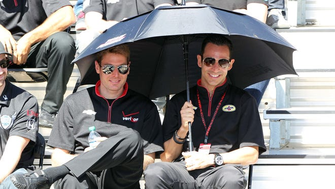 Team Penske cohorts Will Power, left, and Helio Castroneves are tied for the points lead in the Verizon IndyCar Series championship standings. Despite their competitive on-track personalities, they remain good friends away from racing.