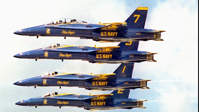 Four members of the Blue Angels flying team practice a line abreast formation Friday, July 19, 1996, in Dayton, Ohio, in preparation for the Dayton Air Show on July 20 and 21. The Blue Angels, who are flying F/A-18 Hornets, are headliners at this year's show. (AP Photo/Keith Ciriegio).