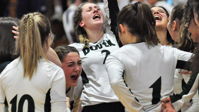 Dover High School volleyball coach Whitney Carrier, facing left, and players, including Samantha Winters, celebrate a win in the Division I semifinals last season. The Green Wave are off to a 5-0 start to this 2020 season.
