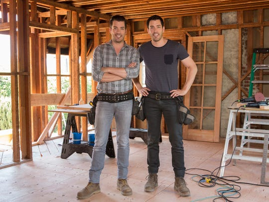 Hosts Jonathan and Drew Scott pause in Drew's honeymoon