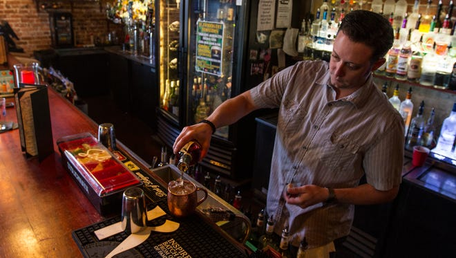 Dominic Cervio, manager at Spirits of Bacchus, prepares a customer's cocktail Wedneasday afternoon (3/16/16) in Downtown Fort Myers.  The establishment will be having to leave its longtime location on Hendry Street in downtown Fort Myers in June.