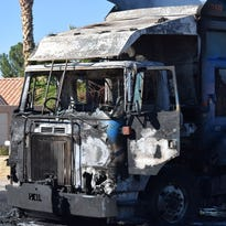 Firefighters work to knock down a fire in a garbage truck on Oct. 20, 2016.