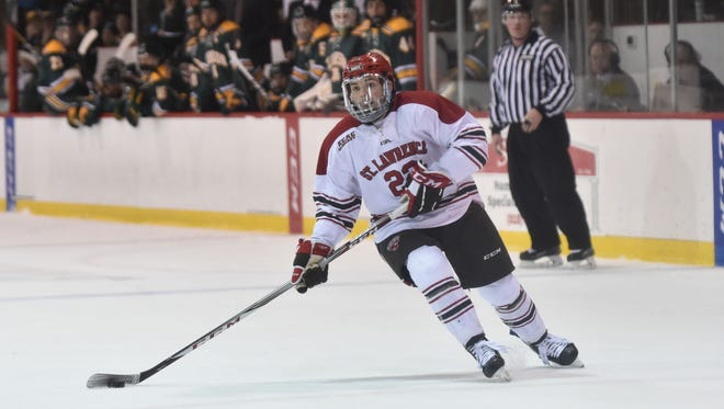 Defenseman Ben Finkelstein, a South Burlington native, is seen in action for the St. Lawrence men's hockey team,