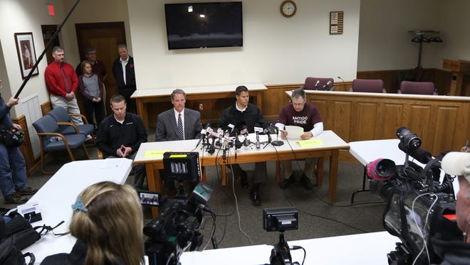 From left: Brian Misfeldt; superintendent, William Greening; Sheriff, Eric Roller; Police chief and High School prinicipal Tom Zanzowi during a press conference regarding the Antigo High School prom shooting Saturday.