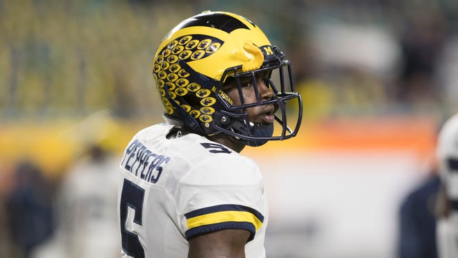 Michigan safety Jabrill Peppers participates in pregame warm-ups.