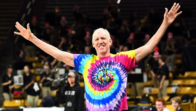 Broadcaster Bill Walton gestures to the crowd before a game between Stanford and Colorado at the Coors Events Center.