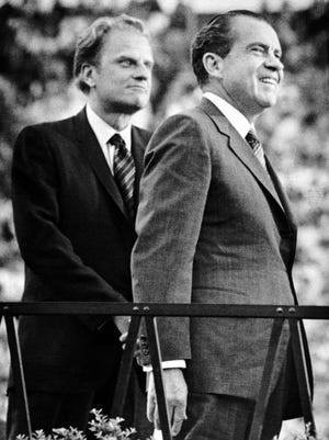 NEWS SENTINEL ARCHIVE In a May 28, 1970, photograph, Billy Graham, left, and President Richard Nixon stand before a crowd of 75,000 people during the evangelist 's East Tennessee Crusade at Neyland Stadium.