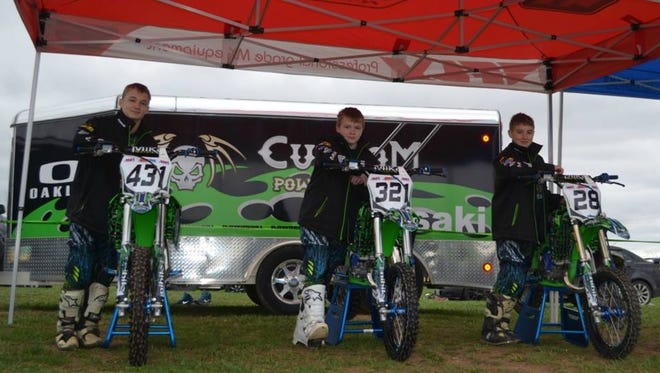 The members of the new Custom Powersports/Spinechillers Racing Kawasaki team are Zach Easter, Clayton Clary and Carsyn Forcum.