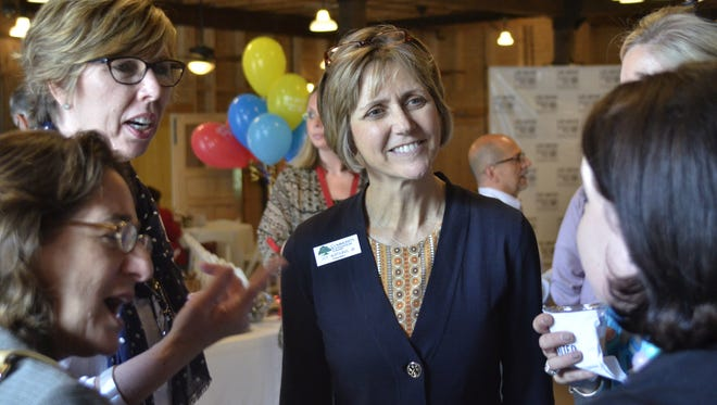 Joy Watkins, president of Community Foundation, speaks with guests at a United Way of the Big Bend event.