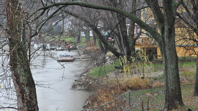 Flooding from the White River is shown reaching homes along River Road, near Keystone Avenue, in 2011. Residents further south in the Warfleigh neighborhood have long awaited a floodwall solution that would protect their homes — and lower their escalating flood insurance premiums.