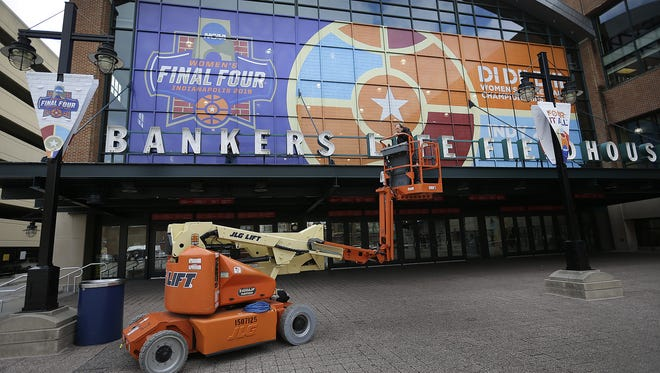 Workers from Sport Graphics, ESPN and Pacers Sport & Entertainment continue their work Friday, Apr 1, 2016, at Bankers Life Fieldhouse getting ready for the NCAA Women's Final Four.